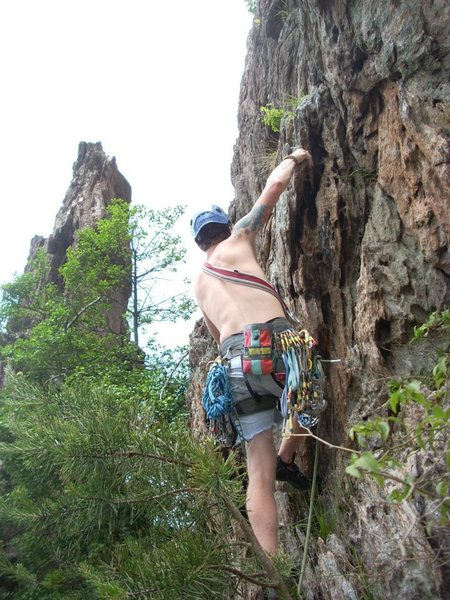 Kenny Johns leads Two Pitch(5.4) with Pinky Pillar in the background.<br> <br> Crowders Mountain State Park, North Carolina