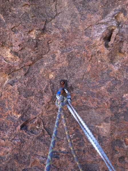 The one bolt at the ledge on top of P1.  Belay can be backed up with a few smaller cams.