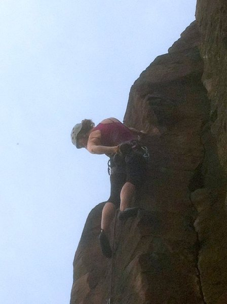 Kristy chalks up before the crux during a Holiday in Cambodia.