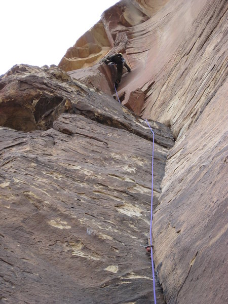 My buddy Kevin topping out the route.