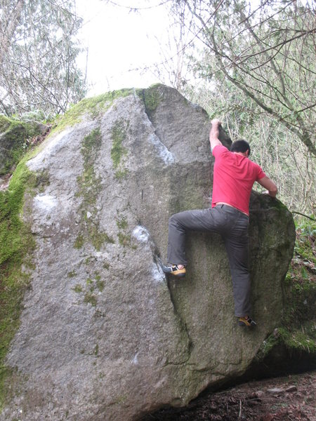 Rock Climbing Photo: Nate working the mid-moves of the problem after ge...