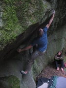 Rock Climbing Photo: Trevor working out of the lip to a big right hand