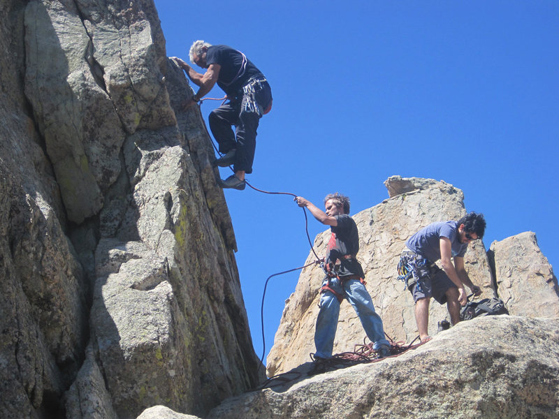 Rock Climbing Photo: Mike and Christian climb, Lluis roots through his ...