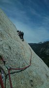 Rock Climbing Photo: Duke on the slightly run-out slab pitch of Tingey'...