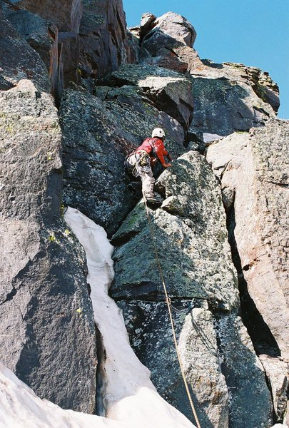 Climbing the summit pitch on Dallas East face.