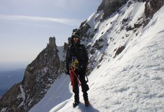 Rock Climbing Photo: Route forms bellow the prominent snow couloir. The...