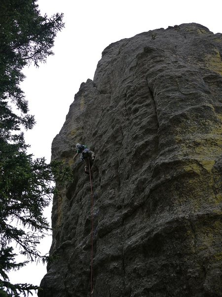 Photo is a little dark but shows you can climb straight up the face, more or less, until the ledge.  Well protected.  Probably the first time I got pumped on a 5.7, trying to figure out what to do next.