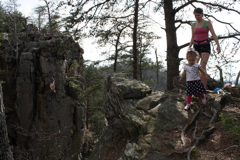 Fortress Wall<br> <br> Ryan Stokes climbs as Nicole and Ava stroll.<br> <br> Crowders Mountain State Park, North Carolina