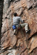Rock Climbing Photo: Rawlhide Wall  Garrett DeBruin sets up for the cru...