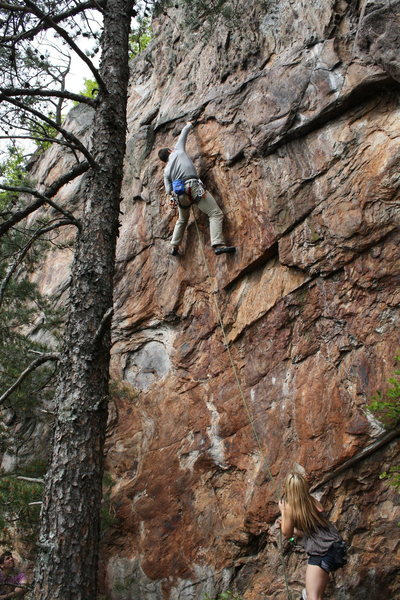 Rawlhide Wall<br> <br> Garrett DeBruin snags the undercling pinch on the crux of <br> <br> Disgustipated (5.11) sport<br> <br> Crowders Mountain State Park, North Carolina