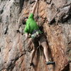 Rawlhide Wall<br> <br> Bennett Harris clings to the Thumbundercling pinch<br> <br> Disgustipated (5.11) sport<br> <br> Crowders  Mountain State Park, North Carolina