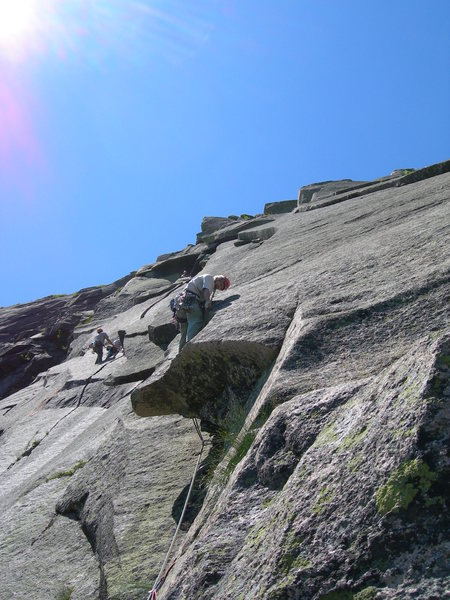 After the first crux, at least for me: pulling on a finger-lock to step back around into this sloping concavity.  Otherwise, you might go up the wrong dihedral (a straight corner instead of the arch).<br> [photo: Paul Dale]