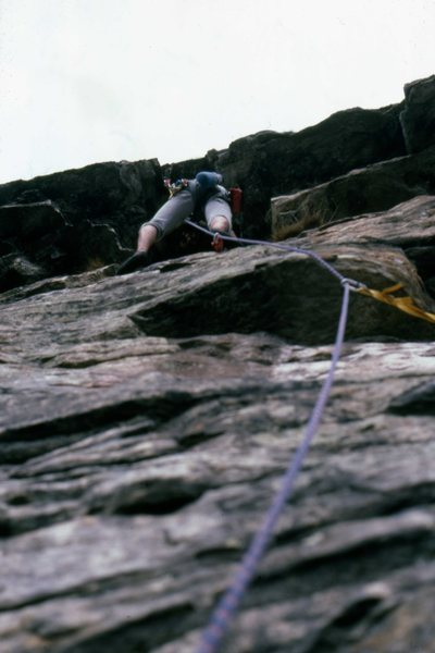 April 5th 1988. Looking up P2 of Lands End from the belay. Mark Taylor on the lead.