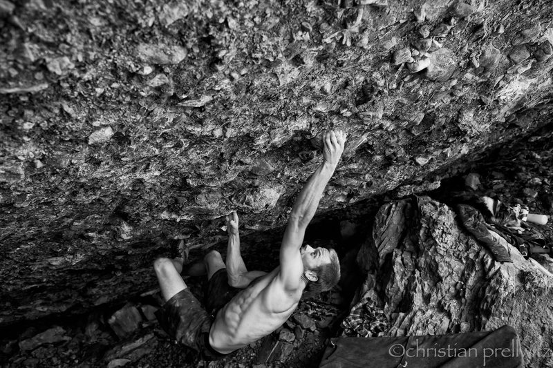 Wylder Wilson projecting a new line on the Gym Boulder in Telluride. V10/11? Photo by Christian Prellwitz.