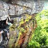 The final moves on Windy Armbuster (5.10d).  Photo by: Trevor Williamson<br> <br> http://www.verticalvoyages.com