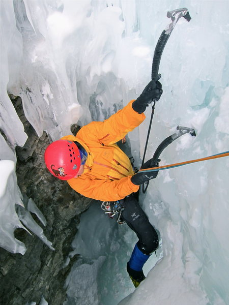 Rolf exiting the cave onto belay 'shroom.