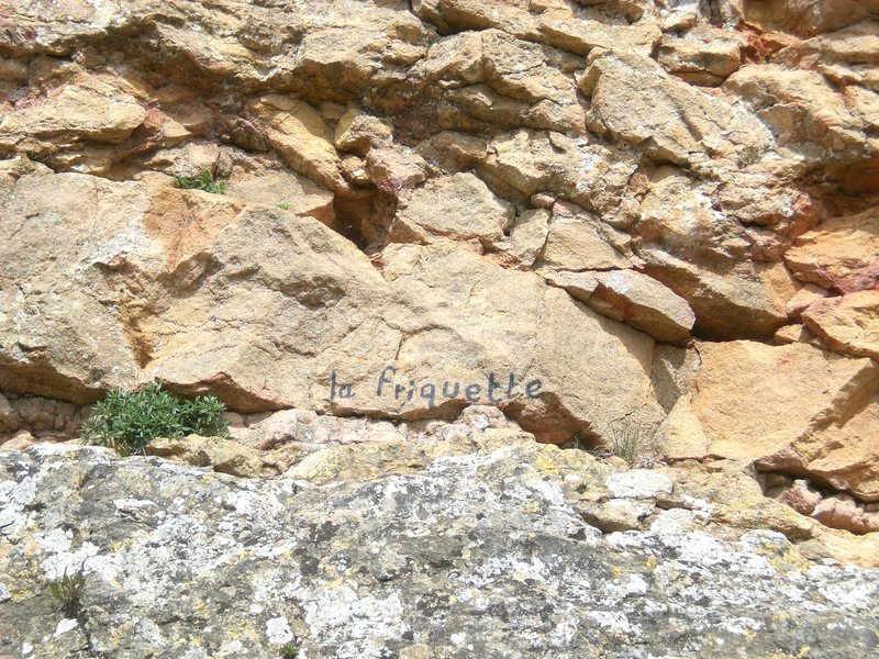 The name of the route is painted on the rock.