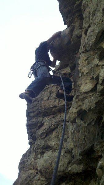 """Caleb at the """"out of place"""" boulder sticking out in the middle of the route"""