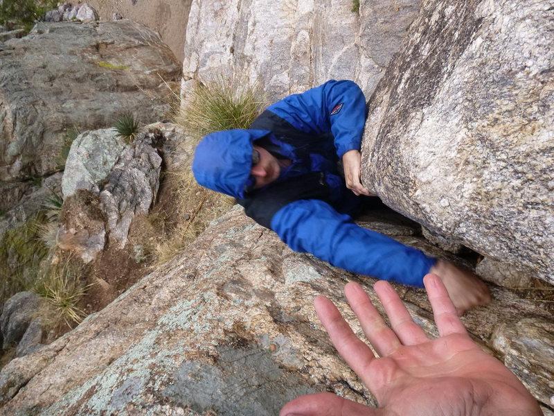 climbing slickrock in the rain