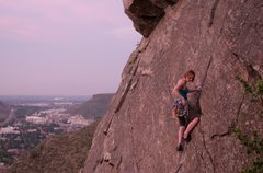 Rock Climbing Photo: Kristin Knudson pauses to plug in some gear as the...