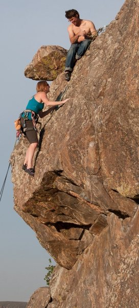 Kristin Knudson conquers the overhang to meet with her belayer, Chris Perkins.  Photo by James Crasta.
