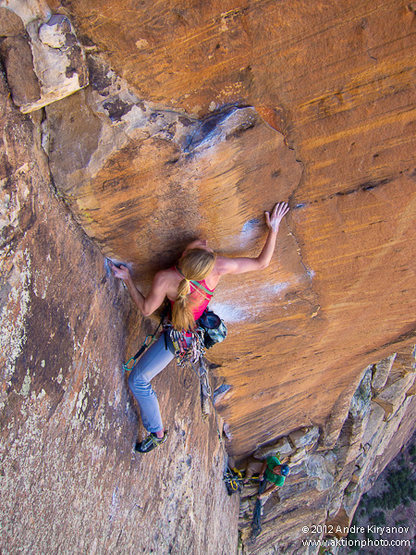 Leah Sandvoss solving the crux of P11 (11d) on Rainbow Wall (Original Route). Photo by Andre Kiryanov