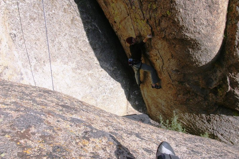 Justin moving through the crux