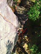 Rock Climbing Photo: Keller cleaning up Moon Face.