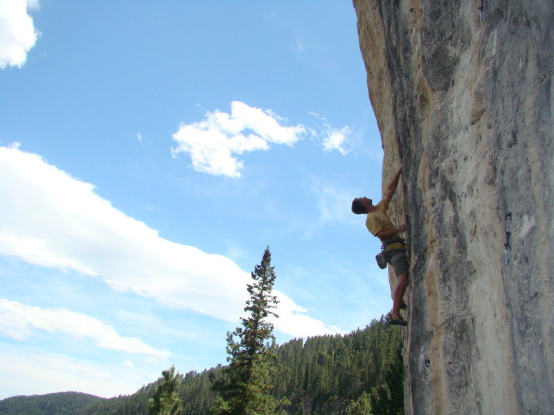 Carl dodges the bullet on Ricochet, 5.12c.<br> <br> <br> Indian Wars Wall. Mohican.<br> <br> Spearfish Canyon, SD.