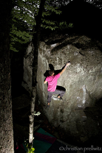 Sticking the crux move of 'Up Into The Green Silence'- Rumney, NH.