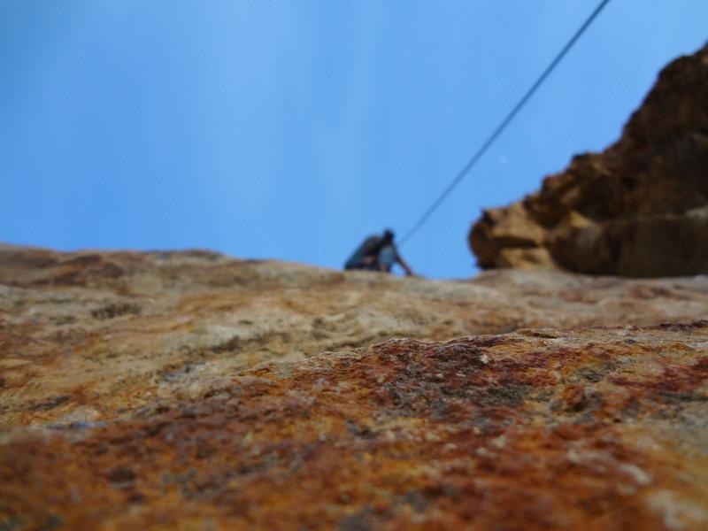Climbing Pink Canoe (5.10a)in Rock Canyon Utah