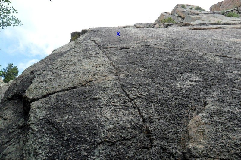 """Miss Bliss follows this thin seam on the far left side of the slab.  Use small nuts or very small cams (smaller than 0.3 Camalot) to protect until you get to the first bolt, at the blue """"x."""""""