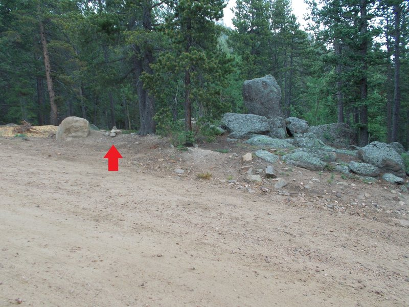 Red arrow marks cairn, after leaving parking area, just past rest room and access road, direct trail to the West Face.