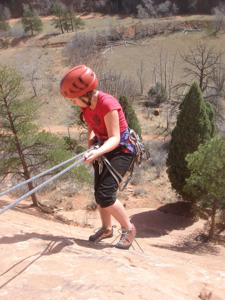 Gabby starts her first ever rappel.