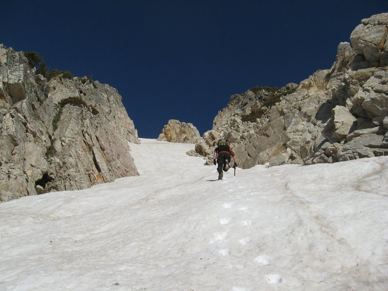 Rock Climbing Photo: Brook kicking steps about halfway up the couloir.
