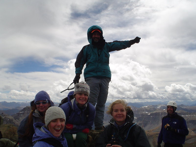 How do you make the summit more beautiful? Doug Bryson celebrates after ascending the Southwest Ridge 2 days before knee surgery for a torn miniscus. These young women had just done South Slopes as their first 14er. 9/11/03. It snowed the next day.