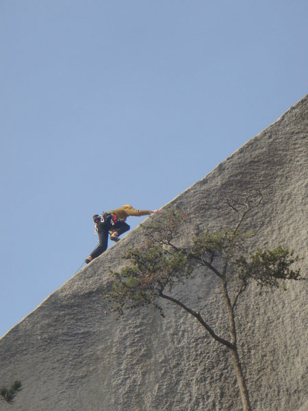Slapping the arete.