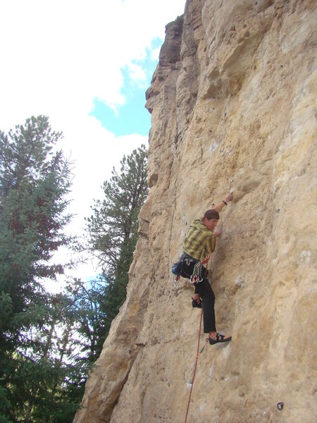 Reggie climbs up Mary Jane, 5.11b.<br> The Danks.<br> Spearfish Canyon, SD.<br> <br> Successful onsight! A great accomplishment since this is one juggy, thuggy, pumpfest of a route.