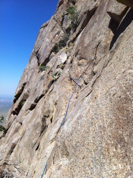 Slanting traverse in Pitch 1 with the piton clipped.