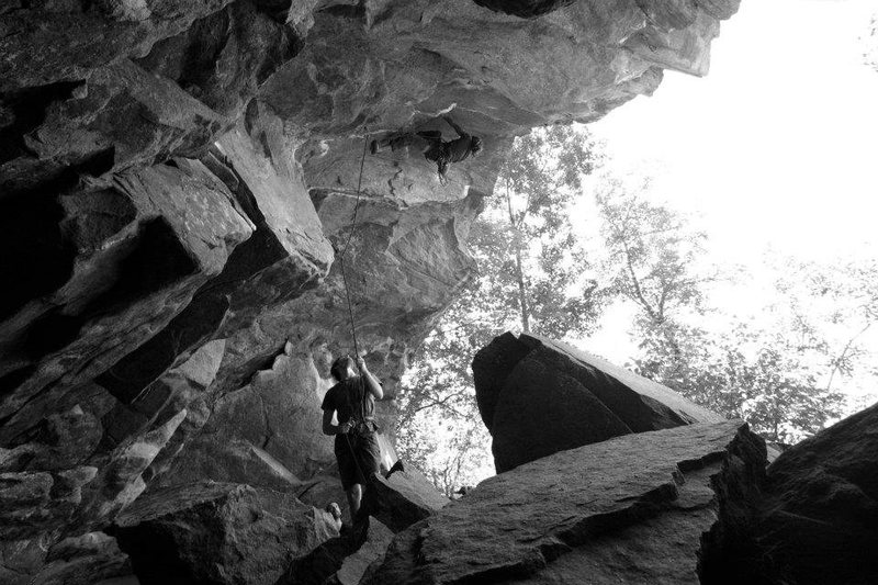 Looking out the cave at a climber on the caged
