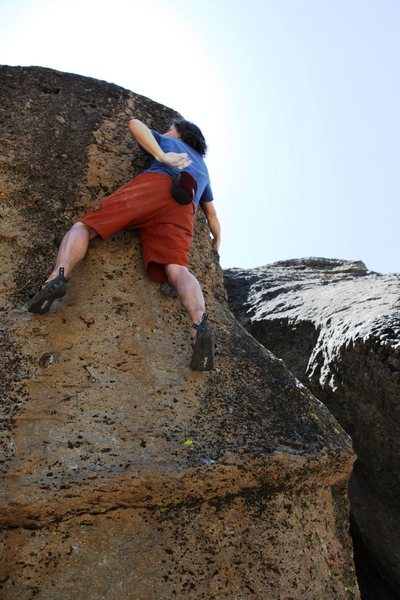 Rock Climbing Photo: Working up the left side of the arete.