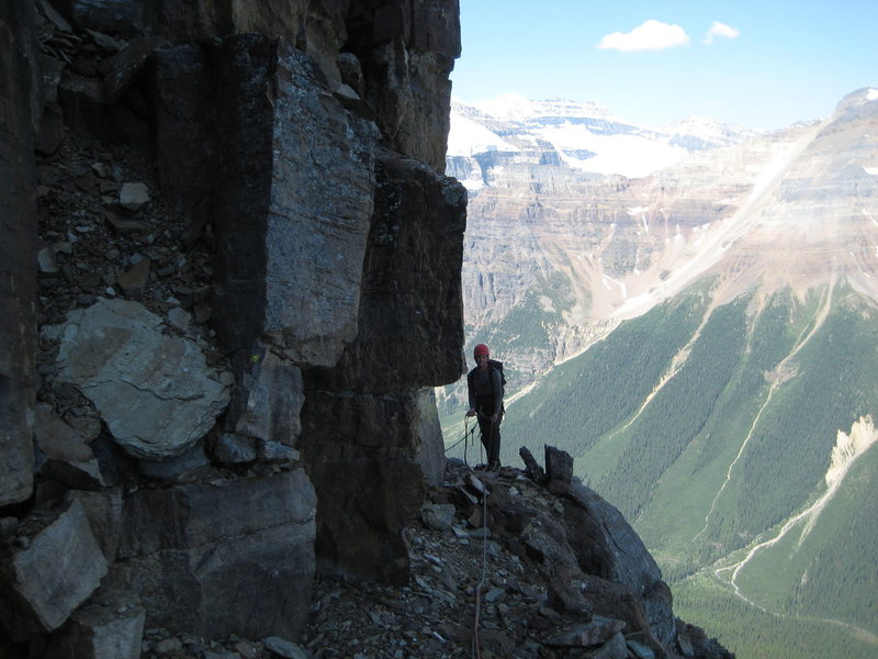 Looking back at Glenn as I began the leftward traverse at about 2/3 height.