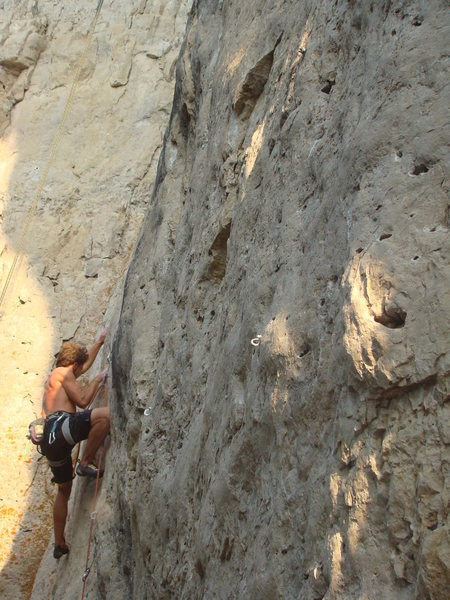 Brian Stampe does battle with Darth Gaydar, 5.12a<br> <br> Darkside Wall, The Darkside.<br> Spearfish Canyon, SD