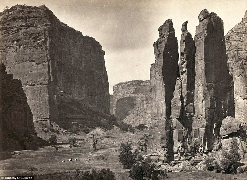 Tents can be seen (bottom, centre) at a point known as Camp Beauty close to canyon walls in Canyon de Chelly National Monument, Arizona. Photographed in 1873 and situated in northeastern Arizona, the area is one of the longest continuously inhabited landscapes in North American and holds preserved ruins of early indigenous people's such as The Anasazi and Navajo.