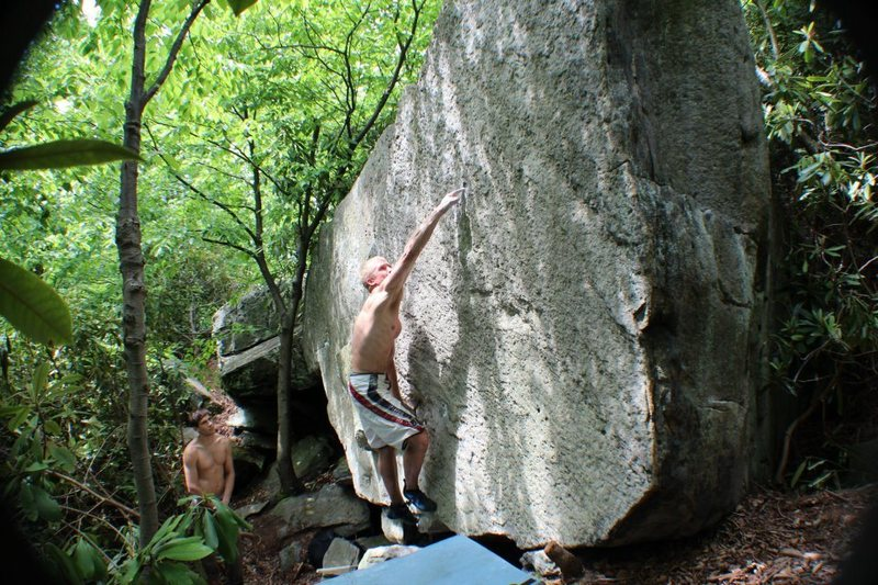 Mike sticking the only hold on the face of Super Moon V9, a newly discovered classic in the Main area.