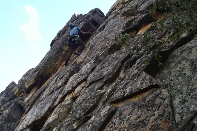 Rock Climbing Photo: Climber cruising through the crux and finishing up...