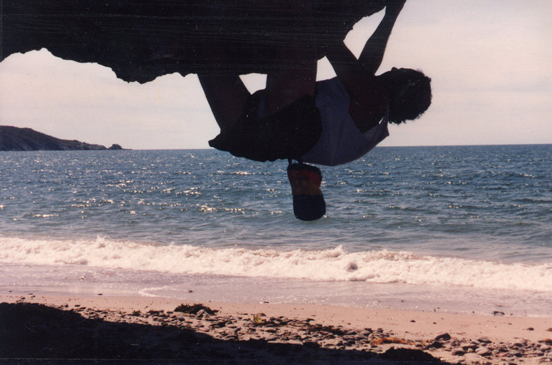 Olaf Mitchell bouldering down the beach from camp.<br> Photo: Mat