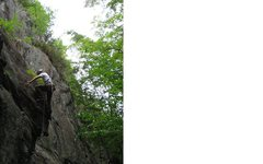Rock Climbing Photo: Photo of the FA, note the nest of gear in the litt...