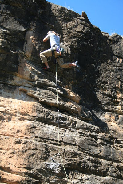 Dean Huwe at the upper crux during FA.