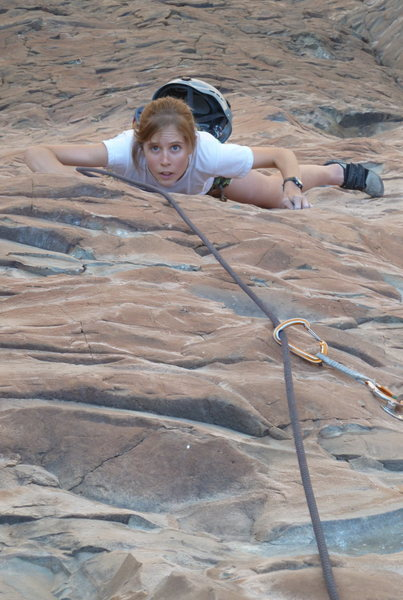 Anna enjoying the fun face climbing on pitch 2.